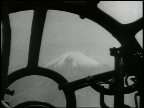 Superfortress bomber aircrafts flying INT pilots looking out toward Mount Fuji EXT B29 flying amp turning away from frame World War II WWII airstrike...