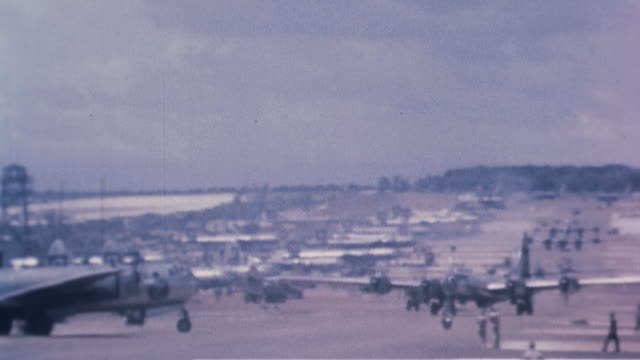 superfortress bombers taxiing to runway for takeoff / guam united states - グアム点の映像素材/bロール