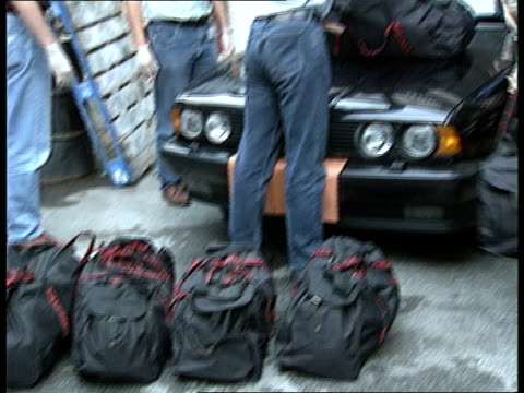 Supergrass Drug Dealers Release ITN LIB London SEQ Heroin haul found in car displayed