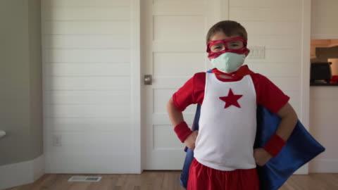 superhjälte pojke med två masker - mod bildbanksvideor och videomaterial från bakom kulisserna