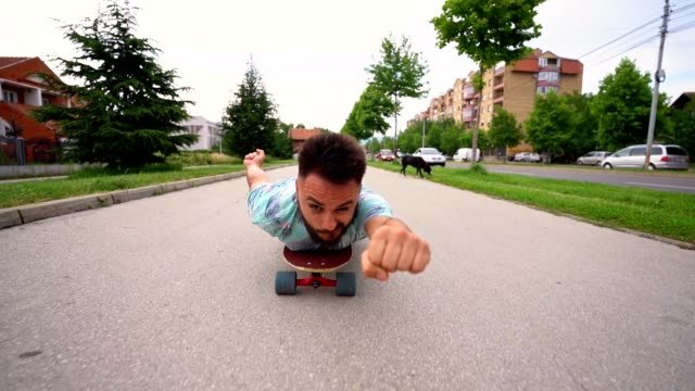 superhero on skateboard - reclining stock videos & royalty-free footage