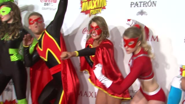 superheroes at patron presents the maxim party featuring cocacola zero countdown with paul mitchell on 2/4/12 in indianapolis in - paul mitchell stock videos and b-roll footage