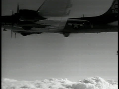 aerial '19411945' superimposed over b17 flying fortress bomber airplanes la ms b17 int ms pilots in cockpit ms bombardier looking down through scope... - bomber plane stock videos & royalty-free footage