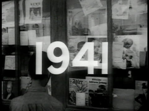 vidéos et rushes de superimposed over boy looking into window w/ magazines displayed hitler on cover of mag in window. wwii - programme de télévision
