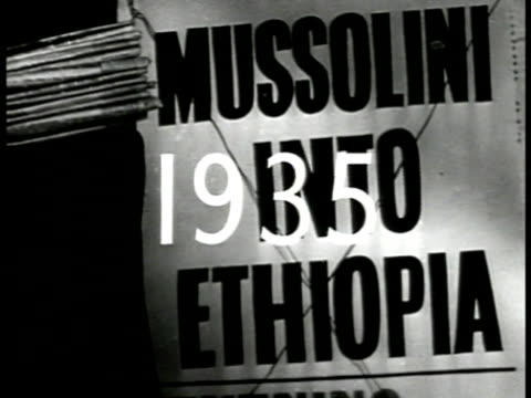 vidéos et rushes de '1935' superimposed over poster 'mussolini into ethiopia' ha xws ethiopian troops marching on field vs italian soldiers firing machine gun tanks on... - 1935