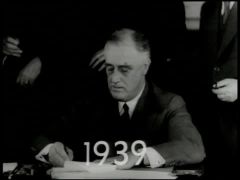 '1939' superimposed over pres franklin d roosevelt signing papers at desk fdr prewwii white house washington dc - 1939 stock videos & royalty-free footage