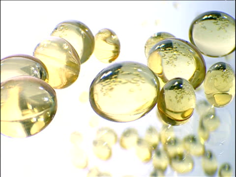 superimposed tracks over translucent capsules - gelb stock-videos und b-roll-filmmaterial