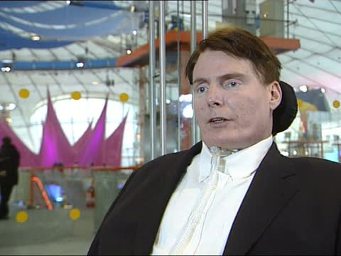 superman star christopher reeve visits millennium dome; a)22.50 annabel roberts england: london: greenwich: millennium dome: int side cms christopher... - spine stock videos & royalty-free footage