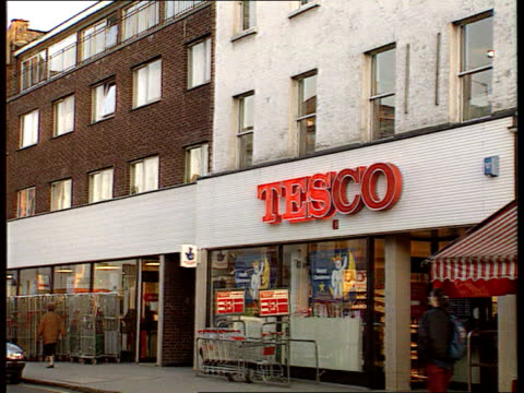 Supermarket blackmailers jailed EXT MS High Street PAN R to branch of Tesco TX supermarket ITN INT MS Customers shopping in store MS Fresh bread...