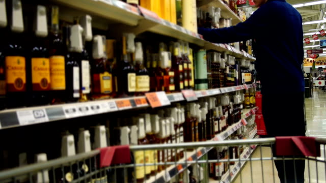 supermarket buying alcohol slow motion - liquor store stock videos and b-roll footage