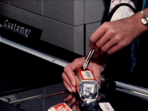 Supermarket cashier uses new electronic barcode reader 1971
