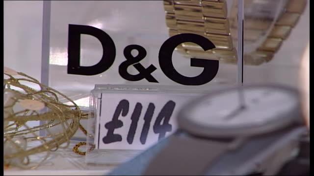 Supermarket cut price designer goods ENGLAND Yorkshire Leeds Asda supermarket INT 'DG' sign next watch on display Umbro shorts paid for at cash till...
