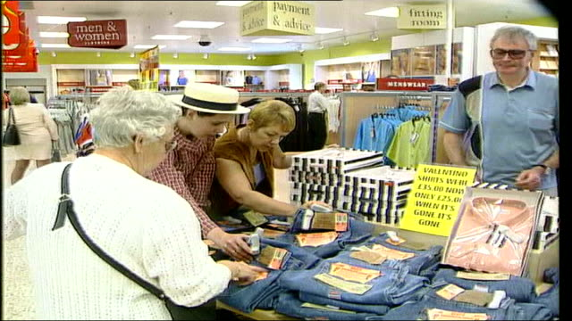 supermarket cut price designer goods; lib england: int customers in supermarket looking at levi's jeans woman next to trolley looking at jeans woman... - levi's stock videos & royalty-free footage