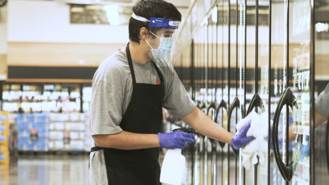 supermarket employee disinfecting the store refrigerators doors - cool box stock videos & royalty-free footage