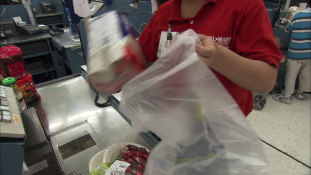 ms supermarket employee putting customer's shopping into bags, beijing, beijing, china - plastic bag stock videos & royalty-free footage