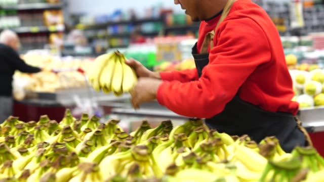 supermarket employee working - banana stock videos & royalty-free footage
