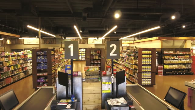 ts ws supermarket shopping aisles and checkout stations without customers - スーパーマーケット点の映像素材/bロール