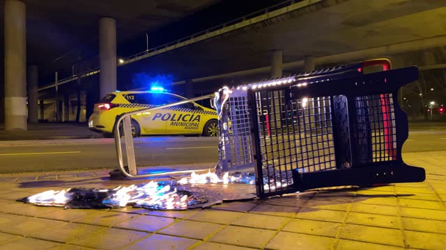 supermarket trolley to transport burning food in the city next to a police car - evacuation stock videos & royalty-free footage