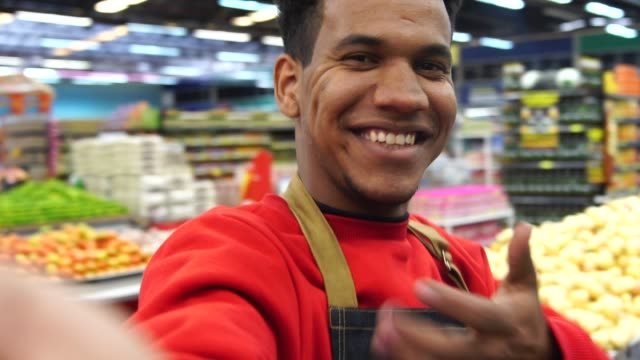 supermarket worker taking a selfie - shop assistant stock videos & royalty-free footage