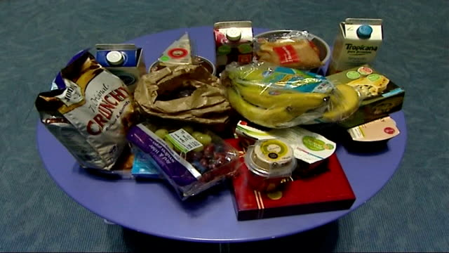supermarkets criticised for overuse of packaging england london int convenience foods from supermarkets laid out on table packaging removed from food... - convenience food stock videos and b-roll footage