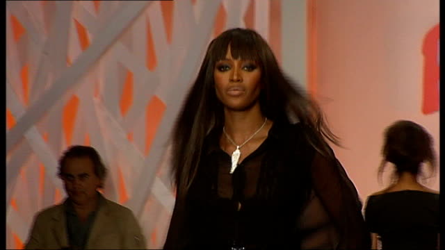 Supermodel Naomi Campbell ordered to give evidence at a war crimes trial LOCATION Campbell down catwalk