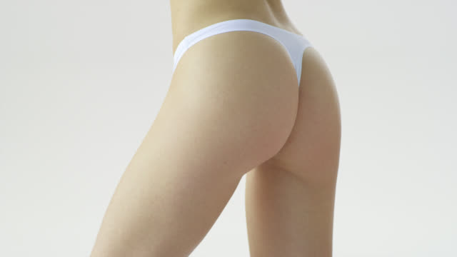 supermodel'‎s parts of body in white underwear: thighs, hips, butt. - thigh stock videos & royalty-free footage