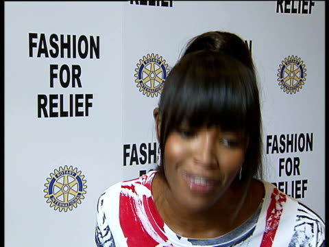 supermodels promote fashion for relief campaign naomi campbell interview sot describes the fashion for relief uk event and problems faced by uk flood... - individual event stock videos & royalty-free footage