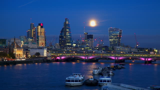 supermoon rises across city of london - supermoon stock videos & royalty-free footage