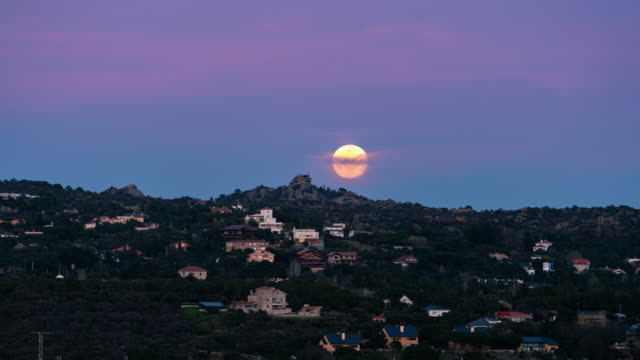 supermoon rising behind palace of canto del pico - supermoon stock videos & royalty-free footage