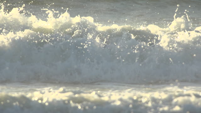 Super-slow motion extreme close-up of ocean waves coming in onto the beach. - Slow Motion - filmed at 240 fps