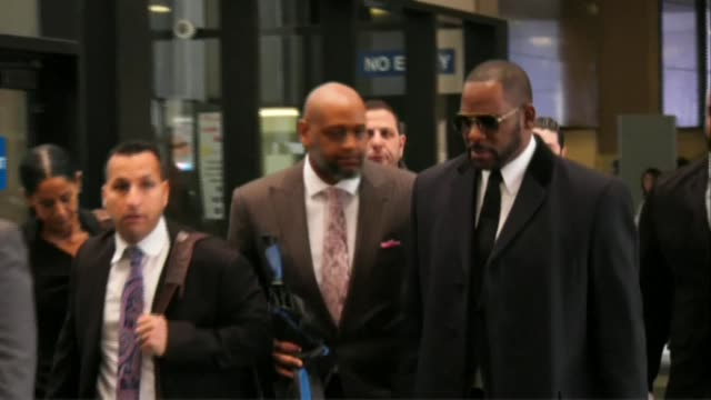 superstar r. kelly arrives for a court hearing. chicago prosecutors charged kelly with 10 counts of aggravated criminal sexual abuse - r. kelly stock videos & royalty-free footage