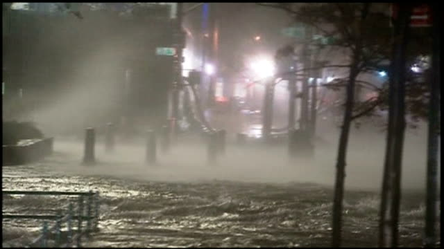 Superstorm Sandy creates havoc on the east coast of America USA New York New York City EXT Brooklyn Bridge Water being whipped up by the wind and...