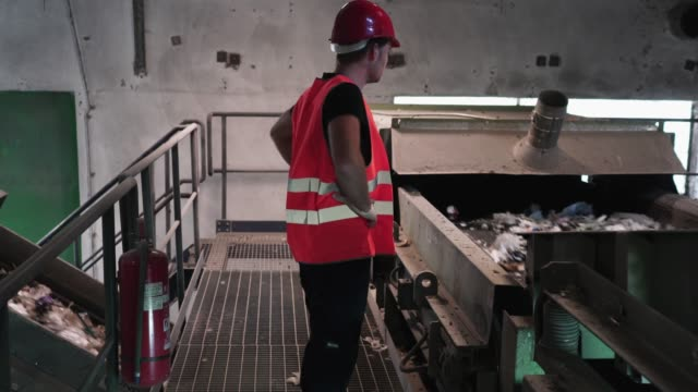supervising the process of waste recycling - garbage disposal stock videos and b-roll footage