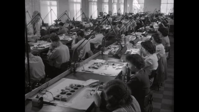 ws supervisor examining while workers working in factory / united states - kunst und kunsthandwerk stock-videos und b-roll-filmmaterial