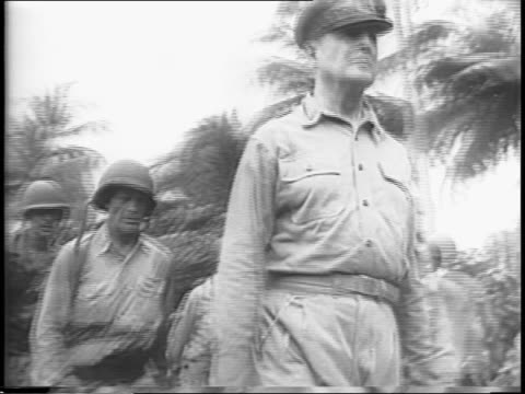 supplies are unloaded on beach in south pacific using makeshift conveyor belts / general douglas macarthur inspects troops / macarthur with... - south pacific ocean video stock e b–roll