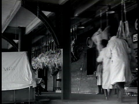 supply trucks at warehouse men pushing butchered hanging beef sides together supply ship at dock stacks of egg crates guarded supplies being loaded... - 1943 stock videos and b-roll footage