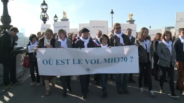 a support committee for the victims of the mh370 flight disappearance held a silent march on sunday in paris one year after the flight disappeared to... - petition stock videos & royalty-free footage
