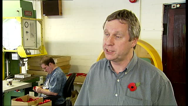 support for army veterans richmonduponthames int people working in factory of royal british legion making remembrance day poppies bill kay interview... - richmond upon thames stock-videos und b-roll-filmmaterial