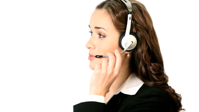 stockvideo's en b-roll-footage met support phone operator in headset talking and smiling - werkneemster