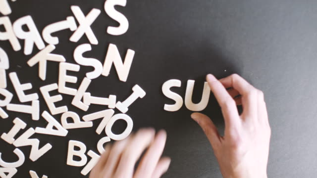 Support Spelled In wooden alphabet