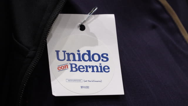 a supporter of presidential nomination hopeful wears a sticker reading united with bernie as 2020 nevada caucus goers gathered at the grand ballroom... - nevada stock videos & royalty-free footage