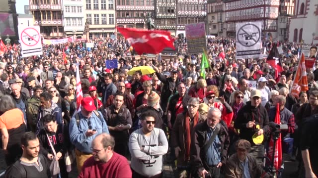 supporter of the blockupy movement demonstrate at the 'roemerber' against the policies of the european central bank after the ecb officially... - ヘッセン州点の映像素材/bロール