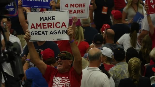 a supporter waves a make america great again sign during a campaign event for us president donald trump at xtreme manufacturing on september 13 2020... - ネバダ州クラーク郡点の映像素材/bロール