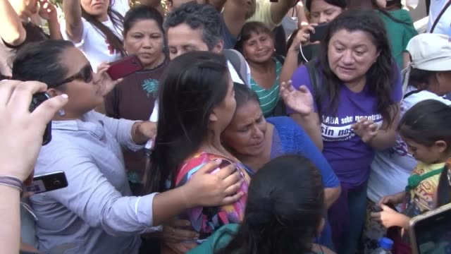 supporters along with family and friends come out to support 20 year old salvadoran rape victim imelda cortez after she leaves court following her... - acquittal stock videos and b-roll footage