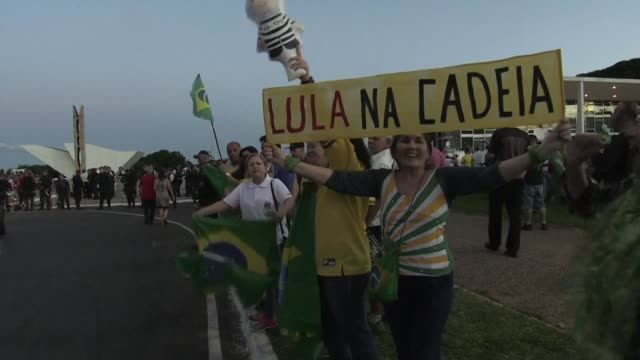 supporters and critics of former brazilian president luiz inacio lula da silva gather in front of the supreme court in brasilia as two judges issued... - court stock videos & royalty-free footage