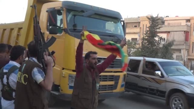 supporters and fighters of the syrian kurdish people's protection units celebrate in the streets in qamishli waving flags after the syrian democratic... - syrian democratic forces stock videos & royalty-free footage