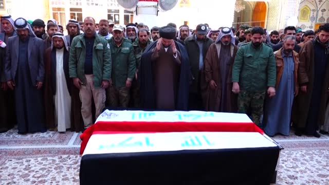 supporters and members of iraq's hashed al-shaabi force burry the fighters of the paramilitary network during a funeral ceremony in the holy city of... - najaf stock videos & royalty-free footage