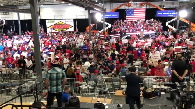 supporters and members of the media wait for us president donald trump at a campaign event at xtreme manufacturing on september 13 2020 in henderson... - ネバダ州クラーク郡点の映像素材/bロール