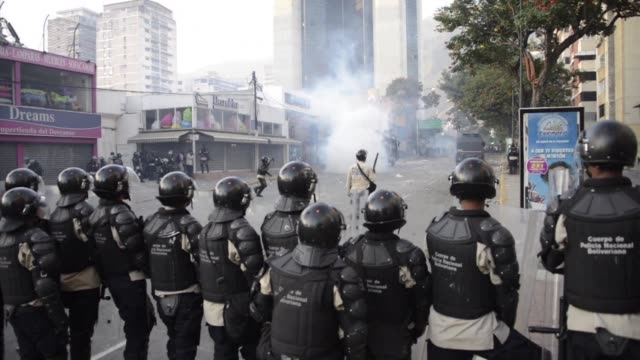 supporters and opponents of venezuela's leftist government stage rival rallies in caracas that take place amid protests and spiraling discontent at... - report produced segment stock videos & royalty-free footage