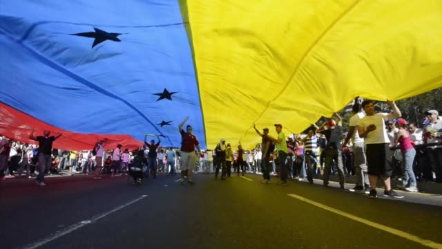 supporters and opponents of venezuela's leftist government staged rival rallies saturday in caracas that took place amid protests and spiraling... - venezuela stock videos & royalty-free footage